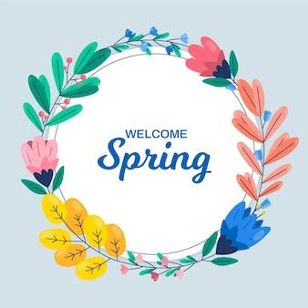 Cadre floral de printemps avec des fleurs et des feuilles colorées