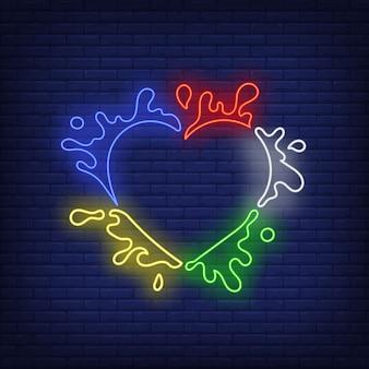Cadre en forme de coeur abstrait avec de la peinture éclabousse enseigne au néon