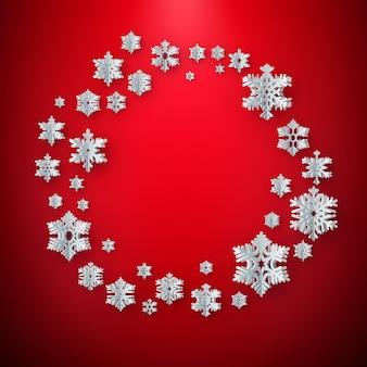 Cadre d'hiver abstrait avec des flocons de neige en papier