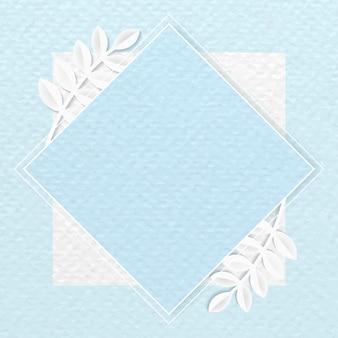 Cadre losange blanc sur fond bleu à motifs botaniques