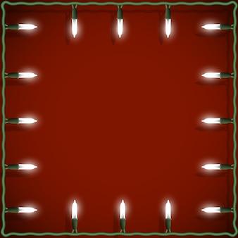 Cadre de lumières de noël sur le rouge