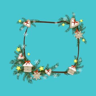 Cadre de noël de branches de sapin avec étoile de pain d'épice et décoration de flocon de neige pour le nouvel an