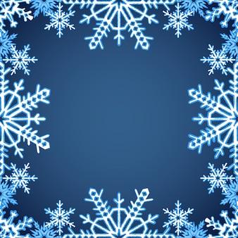 Cadre de noël avec des flocons de neige sur les bords