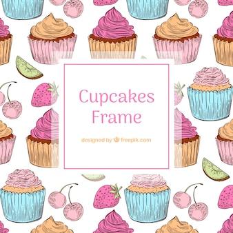 Cadre de nourriture avec des cupcakes