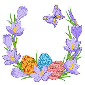 Cadre d'oeufs de pâques lumineux et fleurs de crocus