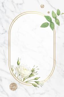 Cadre ovale en or avec fond de feuillage