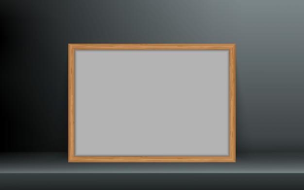 Cadre photo en bois avec une ombre.