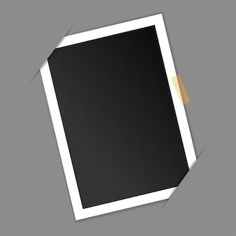 Cadre photo vide sur fond gris