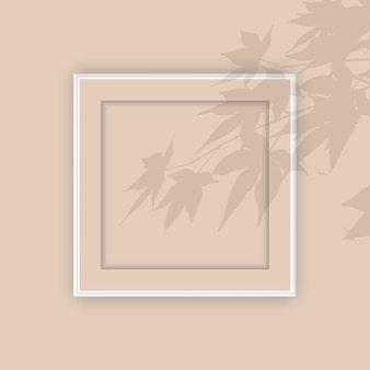 Cadre photo vierge avec une superposition d'ombre végétale
