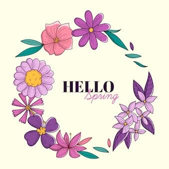 Cadre de printemps dessiné à la main avec des feuilles et des fleurs