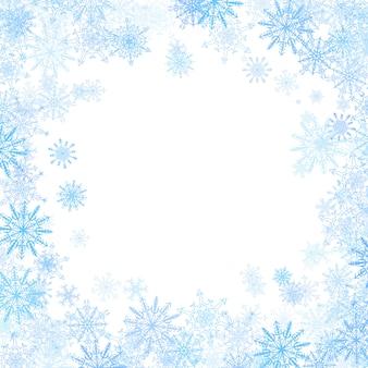 Cadre rectangulaire avec petits flocons de neige bleus