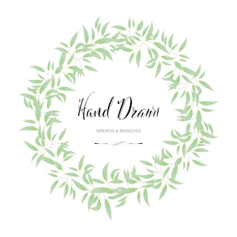 Cadre rond floral et feuille. mariage de fleurs de décoration dessinés à la main.
