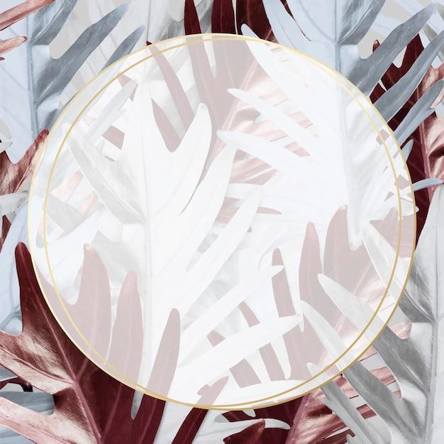 Cadre rond sur fond de feuilles métalliques