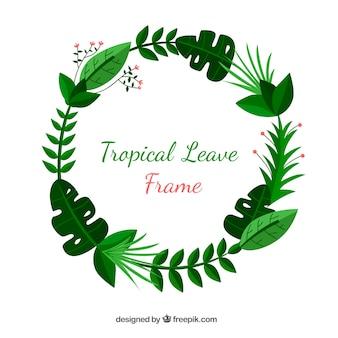 Cadre tropical avec des feuilles vertes