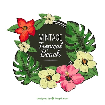 Cadre tropical avec des fleurs dans le style vintage