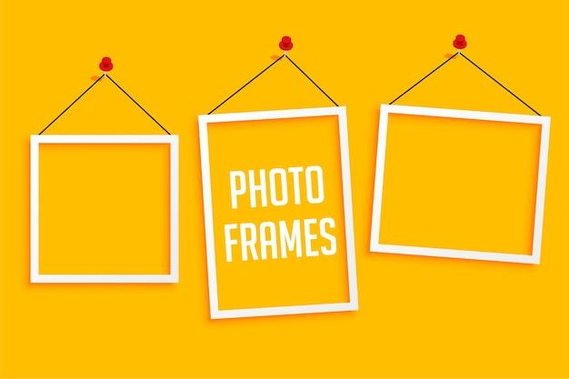 Cadres photo suspendus sur jaune