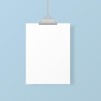 Cadres photo suspendus vierges ou modèles d'affiches isolés sur fond. un ensemble d'affiche blanche accrochée à un classeur au mur. cadre pour une feuille de papier. illustration.
