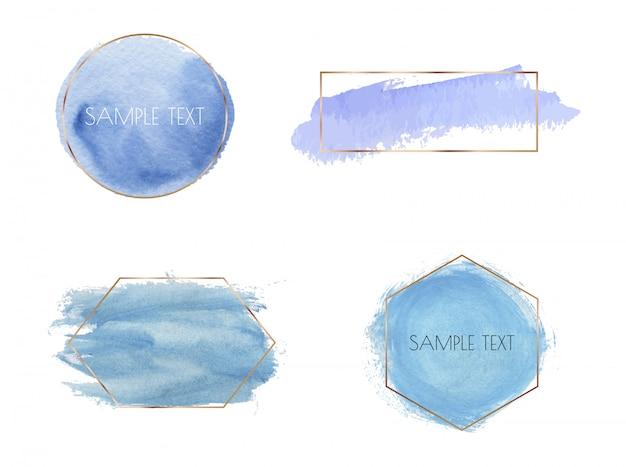 Cadres polygonaux or avec texture aquarelle de coup de pinceau bleu.