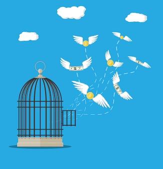 Cage ouverte avec des billets et des pièces d'un dollar volant