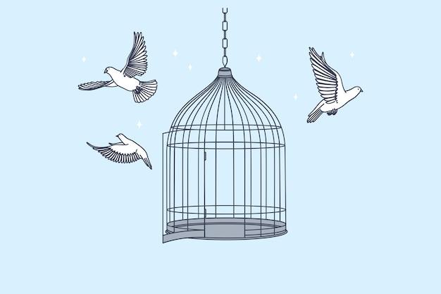 Cage ouverte avec vol d'oiseaux de colombes intérieures