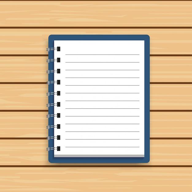 Cahier de bloc-notes spirale réaliste blanc sur bois.