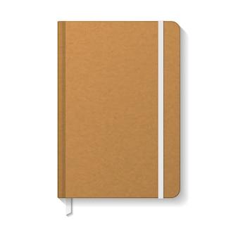 Cahier vierge en papier kraft brun avec modèle de signet élastique et ruban blanc.