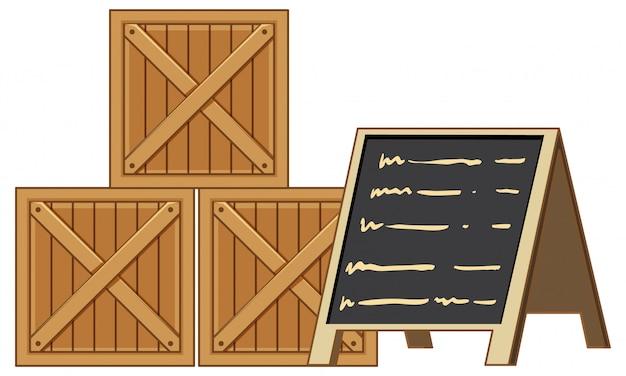 Caisses en bois avec menu tableau noir isolé sur fond noir blanc