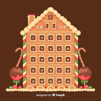 Calendrier de l'avent de noël avec un design de maison en pain d'épice