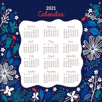 Calendrier du nouvel an 2021 dessiné à la main avec des fleurs bleues