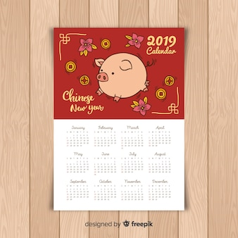 Calendrier du nouvel an chinois cochon dessiné à la main