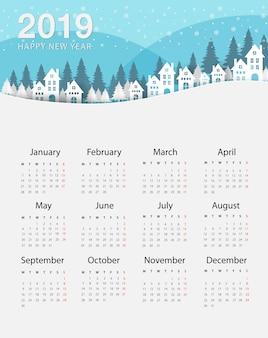 Calendrier nouvel an 2019. maisons de colline en hiver et neige