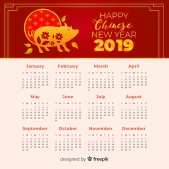 Calendrier de nouvel an chinois de silhouette florale de cochon