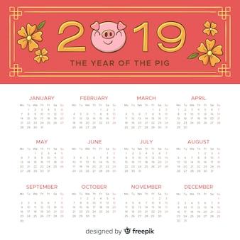 Calendrier de nouvel an chinois de visage de cochon dessiné à la main