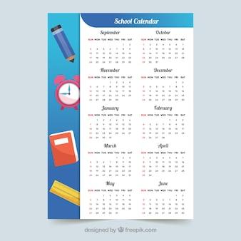 Calendrier scolaire bleu avec éléments scolaires