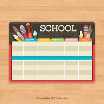 Calendrier scolaire avec crayons et brosses