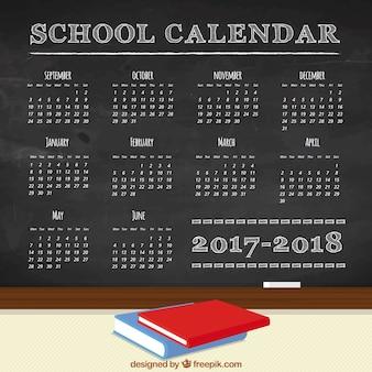 Calendrier scolaire sur un tableau noir