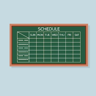 Calendrier avec tableau des heures sur le tableau vert.