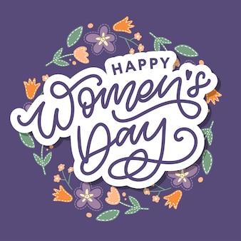 Calligraphie de lettrage manuscrite happy women's day avec des fleurs abstraites