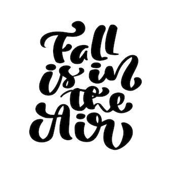 Calligraphie de lettrage de vecteur l'automne est dans le texte de l'air. illustration dessinée à la main pour carte de voeux isolée sur fond blanc. parfait pour les vacances saisonnières, thanksgiving day.