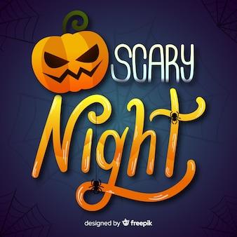 Calligraphie nocturne effrayante et une citrouille orange