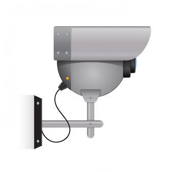 Caméra de sécurité extérieure grise sur le mur