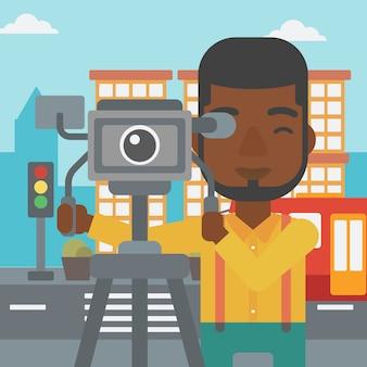 Caméraman avec caméra sur trépied.