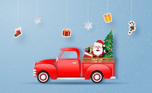 Camion rouge de noël avec le père noël