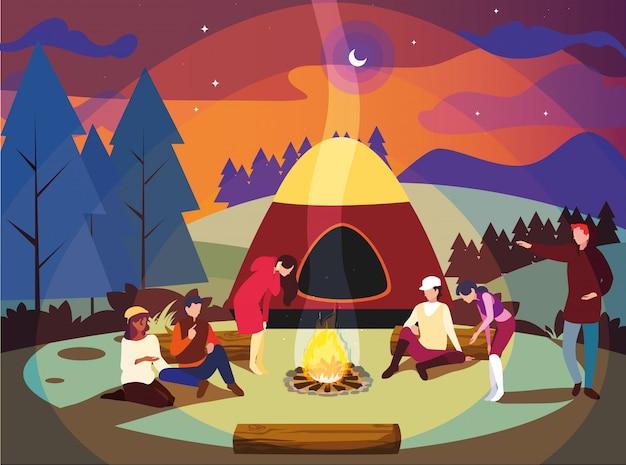 Les campeurs dans la zone de camping avec une scène de nuit sous la tente et un feu de camp