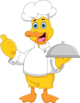 Canard de chef de bande dessinée portant un plateau de nourriture et donnant les pouces vers le haut