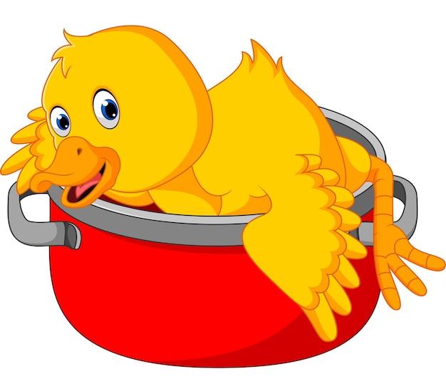 Canard drôle de dessin animé étant cuit dans une casserole