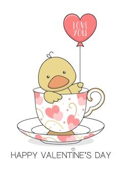 Canard mignon dans une tasse tenant un ballon
