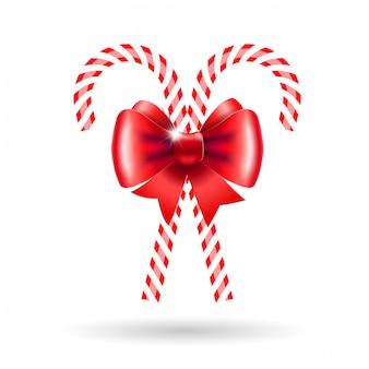 Candy cannes avec un arc rouge.