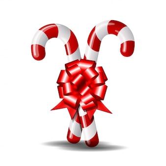 Canne en bonbon de noël avec noeud rouge sur fond blanc. .
