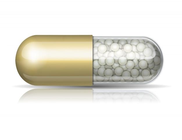 Capsule dorée médicale avec des granules